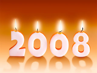 Photo of four candles shapped in the numbers 2008