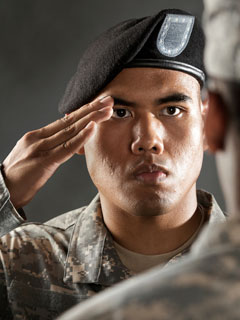 A photo of an American soldier saluting