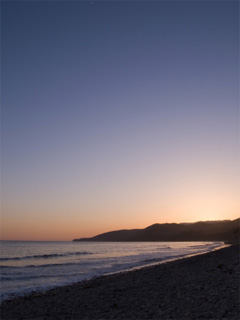 A photo of beach at sunset