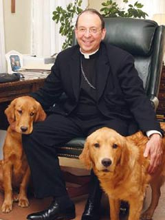 A photo of Bishop Lori with his dogs