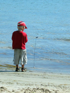 A photo of a small boy fishing