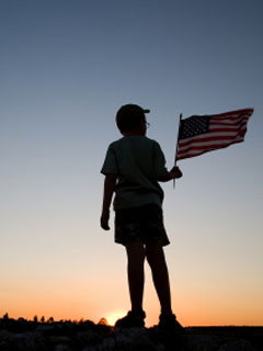 A photo of a boy holding an American flag