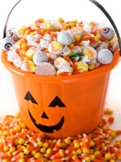 A photo of Halloween candy in a pumpkin shaped bucket