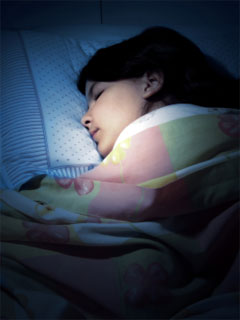 A photo of a child sleeping