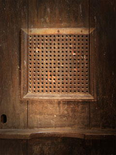 A photo of a Confessional screen
