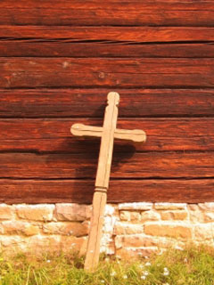 A photo of a cross leaning against a wall