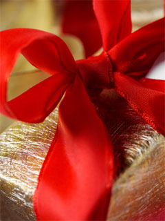 A photo of a gift with a bright red bow