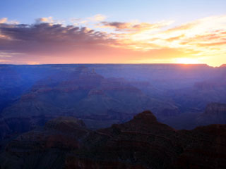 A photo of the Grand Canyon at sunrise