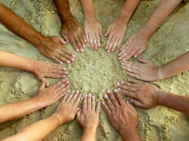A photo of many hands in a circle