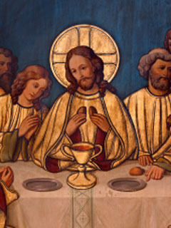 A photo of a painting depicting Jesus breaking bread at the Last Supper