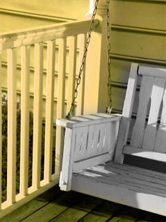 A photo of a porch swing