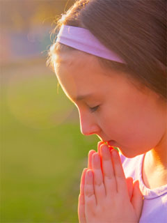 A photo of praying girl