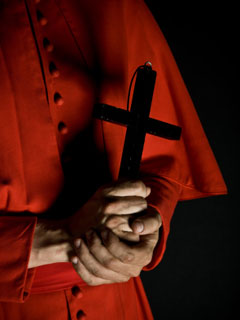 A photo of a Priest holding a cross