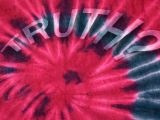 A photo of tie dye shirt with the words TRUTH