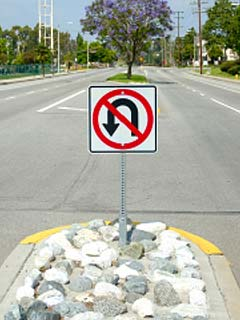 A photo of a U turn sign