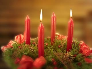 A photo of an Advent Wreath with 2 lighted candles