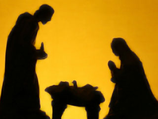 Image of a silhouette of baby Jesus with Mary and Joseph on either side