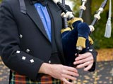 A photo of a bagpipe player