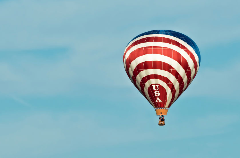 A photo of a red, white, and blue hot air balloon