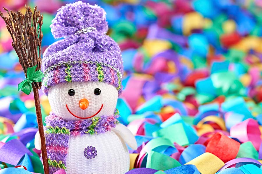A photo of a sock snowman and colorful confetti