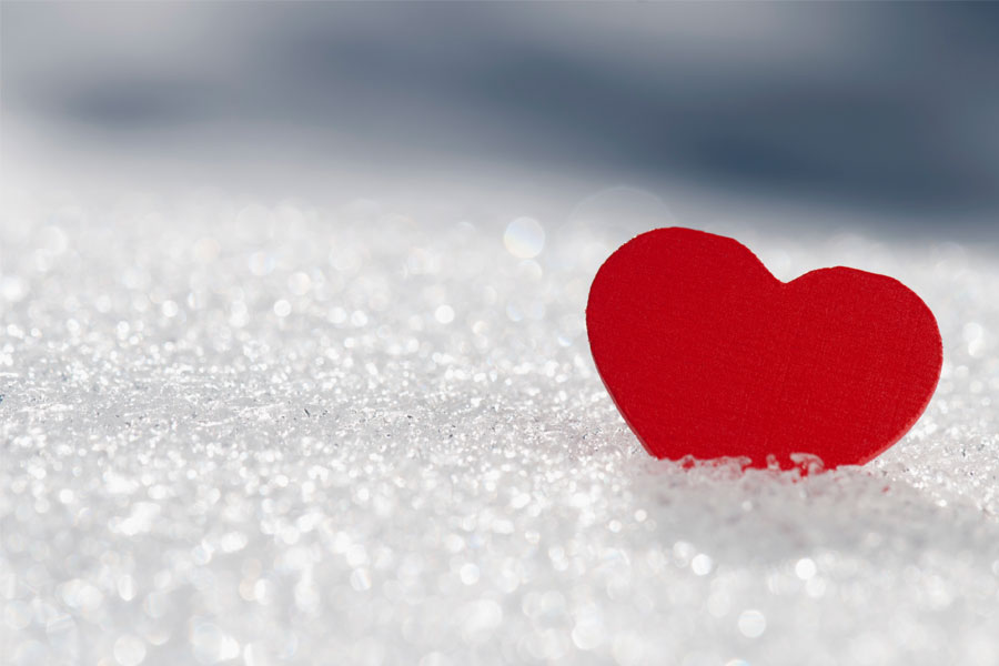 A photo of a heart in the snow