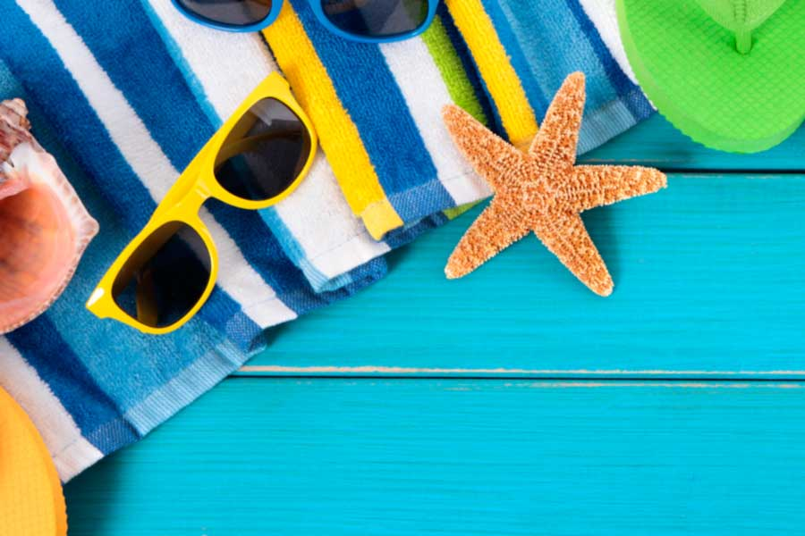 A photo of bright colored beach related items