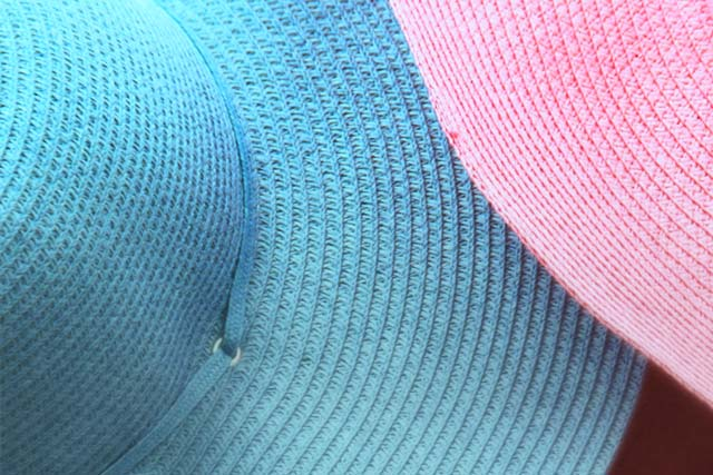 A photo of blue and pink weaved hats.