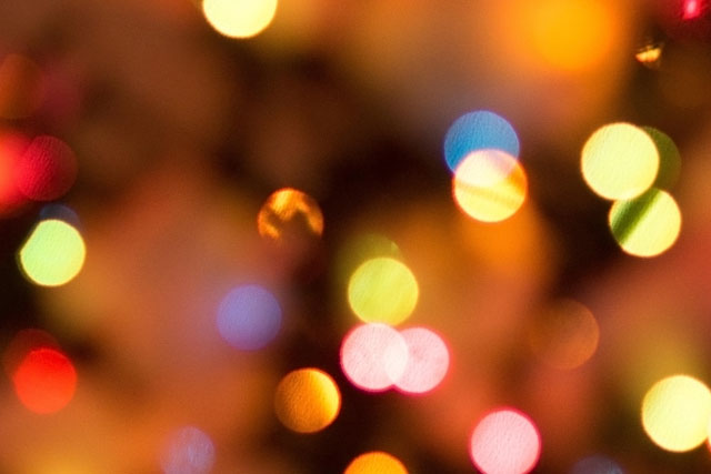 A photo of Christmas lights out of focus.