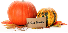 A photo of pumpkins, leaves, and a note that says Give Thanks