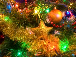 A photo of lights and ornaments on a Christmas tree