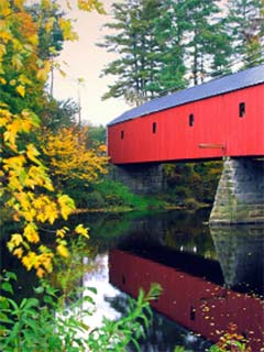 A photo of a red covered bridge
