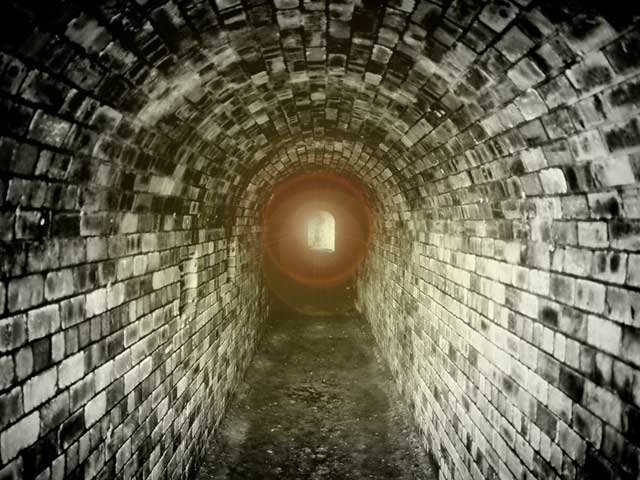 A photo of light at the end of a dark tunnel