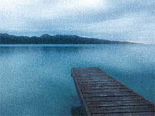 A photo of a quiet and empty lake and one small dock over the water