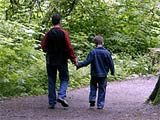 Photograph of a father walking with his son