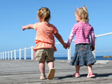 Photo of two young girls holding hands