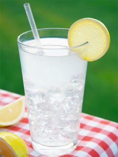 A photo of a tall glass of ice cold lemonade