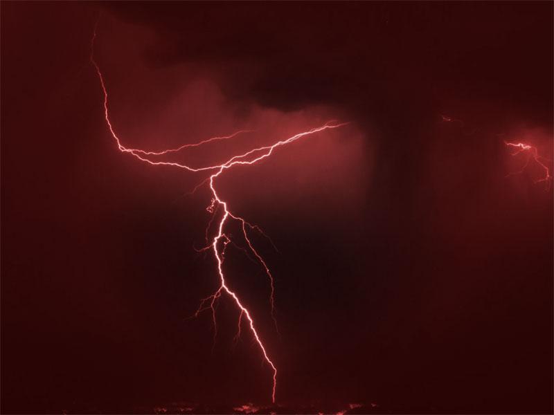 A photo of lightning against a dark night sky