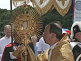 Biship Lori Carries The Monstrance
