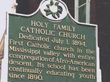Photo of the sign in front of the Holy Family Church in Natchez, Mississippi