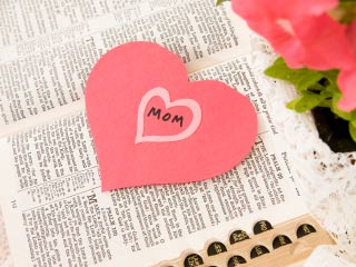 Photo of a paper heart cut-out on a bible