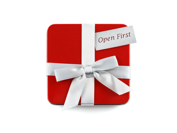 A photo of a present that says 'Open First'