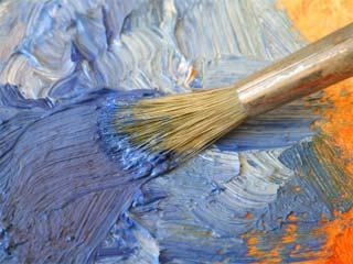 A photo of a paintbrush on a canvas with paint