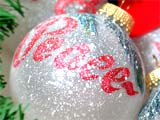 A photo of Christmas ornament with the word Peace