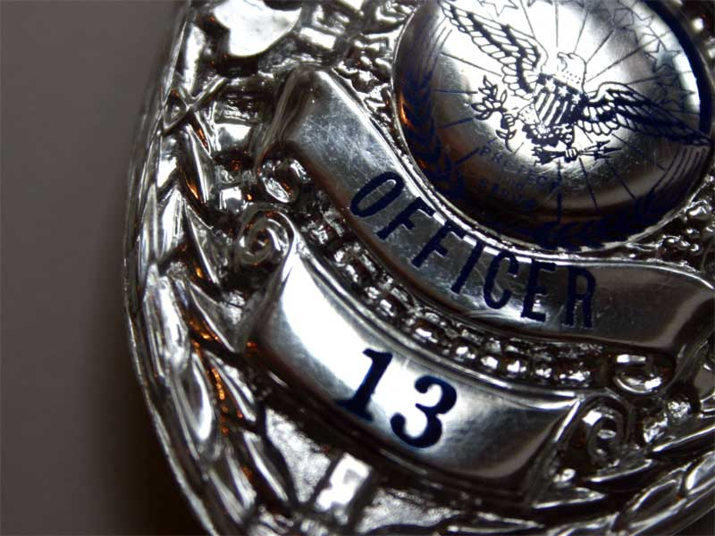 An photo of a police badge.