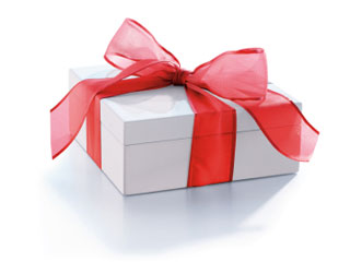 A photo of a white present with a red bow