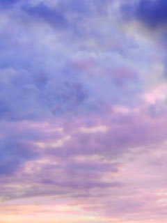 A photo of a purple sky with clouds