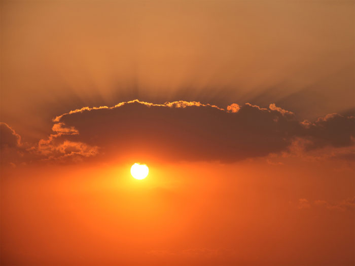 A photo of bright orange sun set