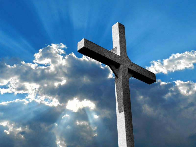 A photo of a cross against the sky