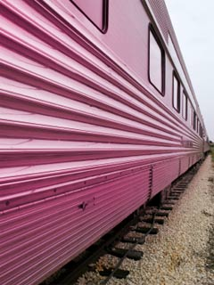 Photo of the side of a train passenger car