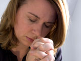 Photo of a woman in prayer